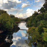 Photo taken at Barton Springs Pedestrian Bridge by Justin S. on 10/11/2013