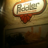 Photo taken at The Peddler Steakhouse by Amy G. on 10/27/2012