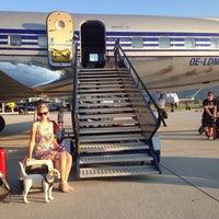 Photo taken at Hangar 8 by Alesia C. on 8/23/2015