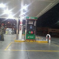 Photo taken at Oxxo Gas by Carlos A. on 12/31/2011