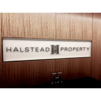 Photo taken at Halstead Property - Flagship Office by Deniz K. on 1/18/2013