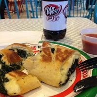 Photo taken at Famous Famiglia Pizzeria by Oscar Alejandro on 1/10/2013