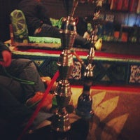 Photo taken at Sphinx Hookah Bar & Cafe by Brandon T. on 11/20/2012