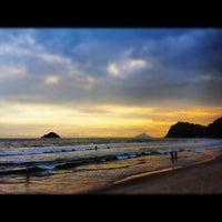 Photo taken at Praia de Guaecá by Ana J. on 12/26/2012