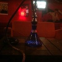 Photo taken at Eastown Hookah Lounge by Neal M. on 12/19/2012