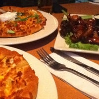 Photo taken at Boston Pizza by Kevin G. on 1/12/2013