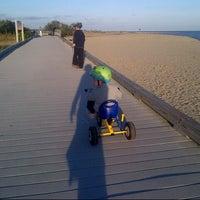 Photo taken at Silver Sands State Park Boardwalk by Maya B. on 10/3/2014