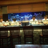 Photo taken at Sushi Axiom by Amy S. on 10/24/2012