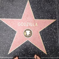 Photo taken at Godzilla's Star, Hollywood Walk of Fame by Sari-Beth on 3/24/2014