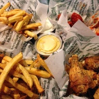 Photo taken at Wingstop by Derick T. on 8/31/2014