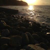 Photo taken at Santubong Beach by Aisyah Z. on 2/1/2013