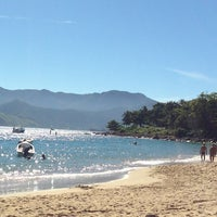 Photo taken at Praia do Curral by Tathiane L. on 7/6/2013