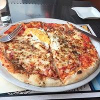 Photo taken at Pizza Momo by Paula I. on 7/20/2016