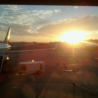 Photo taken at Gate 23 by Andreas N. on 10/8/2012