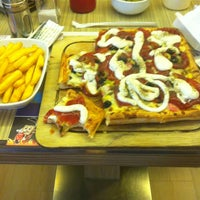 Photo taken at Kare Pizza by Betul . on 3/13/2013