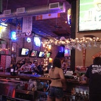 Photo taken at Bikinis Sports Bar & Grill by Maurice H. on 11/26/2012