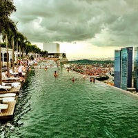 Photo taken at Rooftop Infinity Pool by Minh T. on 12/23/2012