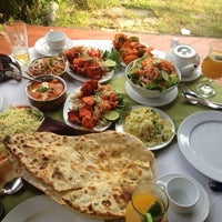Photo taken at Ganesh Indian Restaurant by Yana K. on 1/12/2013