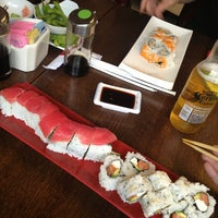 Photo taken at Sushi Garden by Emily D. on 9/2/2013