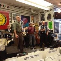 Photo taken at Louisiana Music Factory by Parrots_RYOKO on 12/7/2013