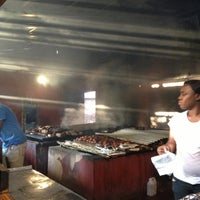Photo taken at Scotchies Jerk Centre by Clay V. on 12/28/2012