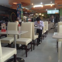 Photo taken at Library Café by PEACE A. on 12/2/2013