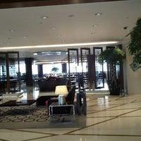 Photo taken at Sofitel Hyland Hotel by Claudio Biaggio P. on 10/10/2012