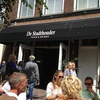 Photo taken at Grand Café De Stadthouder by Dennis K. on 6/30/2013
