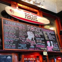 Photo taken at Rogue Ales Public House & Distillery by Julian F. on 10/13/2012