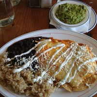 Photo taken at Life Cafe 983 by Katherine B. on 4/25/2013