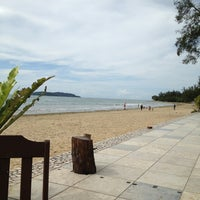 Photo taken at Tanjung Aru 1st Beach by Nis H. on 1/5/2013