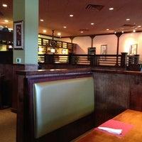 Photo taken at Mojo Asian Cuisine & Sushi Bar by Eric G. on 4/3/2013