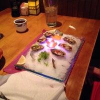 Photo taken at Mojo Asian Cuisine & Sushi Bar by Eric G. on 9/7/2013