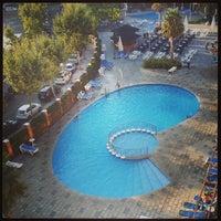 Photo taken at Hotel California Garden by Alexander K. on 8/21/2013