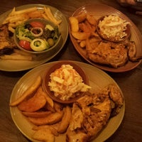 Photo taken at Nando's by Sherry C. on 4/12/2013