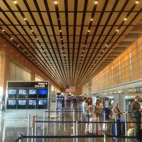 Photo taken at Boston Logan International Airport (BOS) by Peiyi F. on 7/13/2013