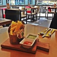 Photo taken at Zafran Restaurant by Aisha A. on 6/17/2013