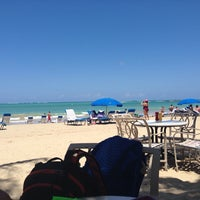 Photo taken at Isla Verde Beach - Balneario Isla Verde (La Playa) by Hugo B. on 4/2/2014