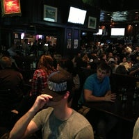 Photo taken at Christie's Sports Bar by Lesley H. on 12/31/2012