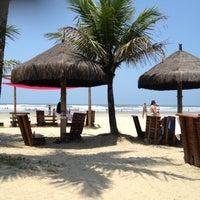 Photo taken at Praia do Sesc Bertioga by Krau F. on 10/27/2012