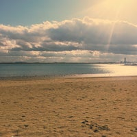 Photo taken at Constitution Beach by Anastasia D. on 12/27/2016