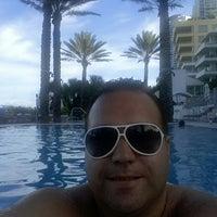 Photo taken at Poolside@ Miami Mariott by Thiago R. on 9/4/2014