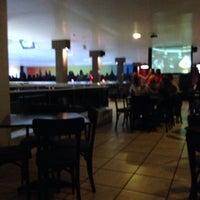 Photo taken at Strike Boliche Bar by Kauê N. on 1/25/2014
