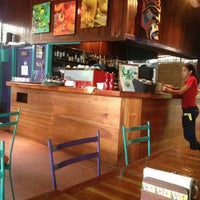 Photo taken at Café Milagro in Manuel Antonio by Divian B. on 6/27/2013