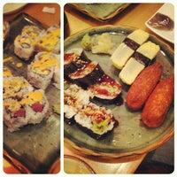 Photo taken at Momo Sushi & Cafe by Luke S. on 11/30/2012