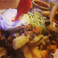 Photo taken at Araujo's Restaurant by LeO S. on 6/7/2014