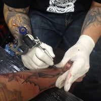 Photo taken at Inkstop Tattoo by Mark R. on 10/16/2013