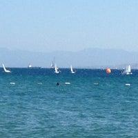 Photo taken at Hayat Bana Güzel Beach by Elif on 9/4/2012