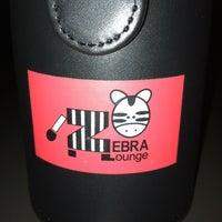 Photo taken at Zebra Lounge by Catherine C. on 12/28/2012