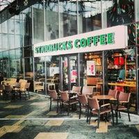 Photo taken at Starbucks by Kun A. on 12/24/2012